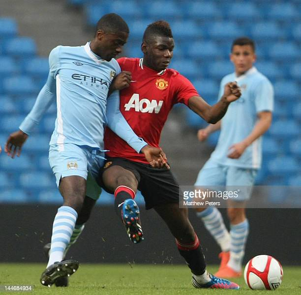 Paul Pogba of Manchester United Reserves clashes with Abdul Razak of Manchester City Reserves during the Manchester Senior Cup Final between...