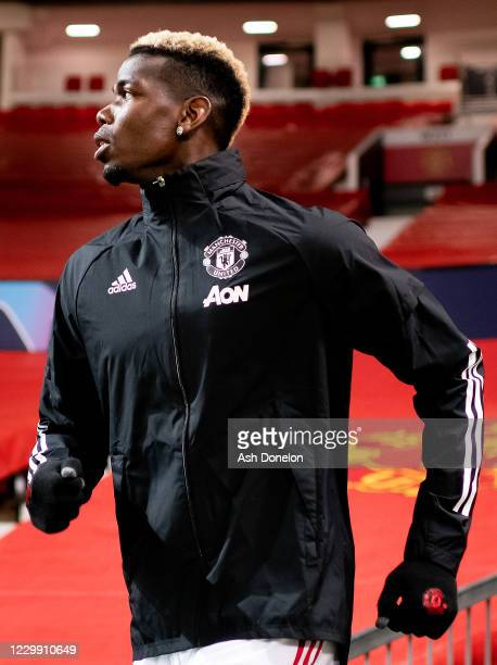 Paul Pogba of Manchester United runs out to warm up prior to the UEFA Champions League Group H stage match between Manchester United and Paris...