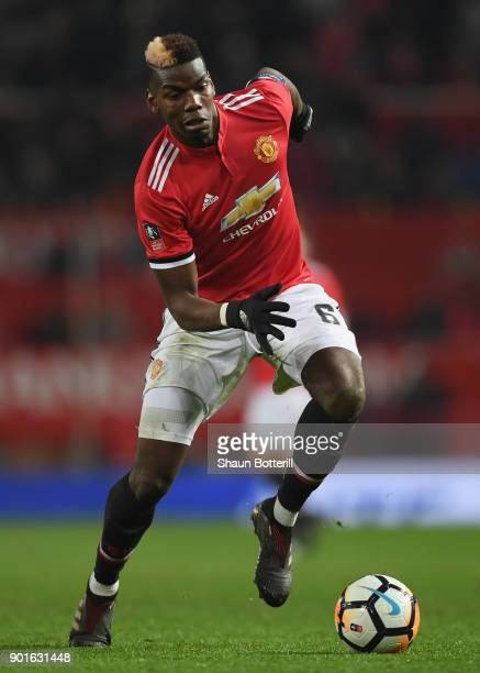 Paul Pogba of Manchester United runs with the ball during the Emirates FA Cup Third Round match between Manchester United and Derby County at Old...