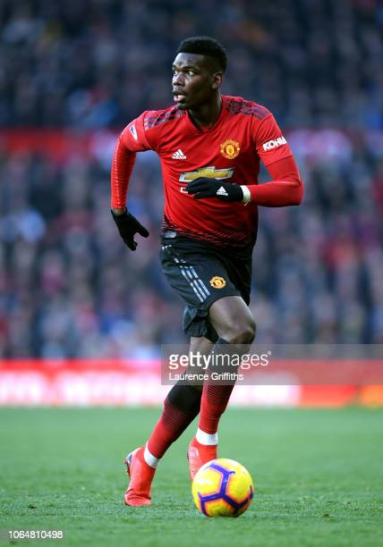 Paul Pogba of Manchester United runs with the ball during the Premier League match between Manchester United and Crystal Palace at Old Trafford on...