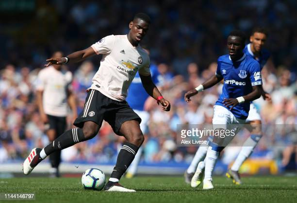 Paul Pogba of Manchester United runs with the ball during the Premier League match between Everton FC and Manchester United at Goodison Park on April...