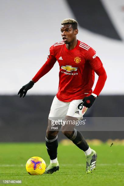 Paul Pogba of Manchester United runs with the ball during the Premier League match between Fulham and Manchester United at Craven Cottage on January...