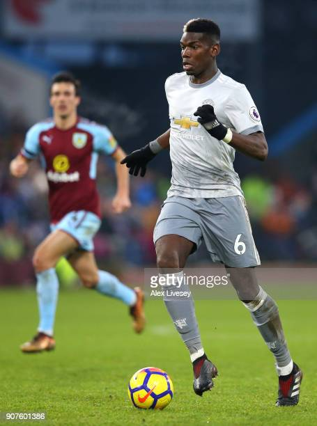 Paul Pogba of Manchester United runs with the ball during the Premier League match between Burnley and Manchester United at Turf Moor on January 20...