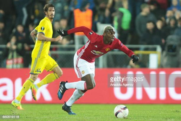 Paul Pogba of Manchester United runs with the ball during the UEFA Europa League Round of 16 first leg match between FC Rostov and Manchester United...