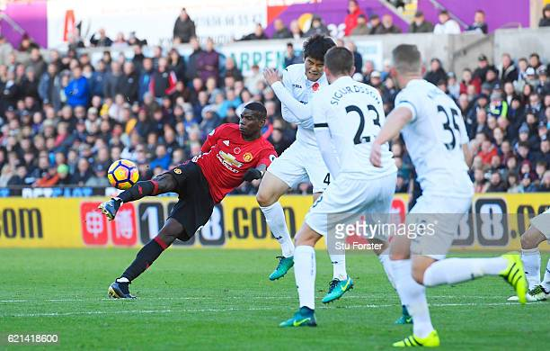 Paul Pogba of Manchester United scores his sides first goal during the Premier League match between Swansea City and Manchester United at Liberty...