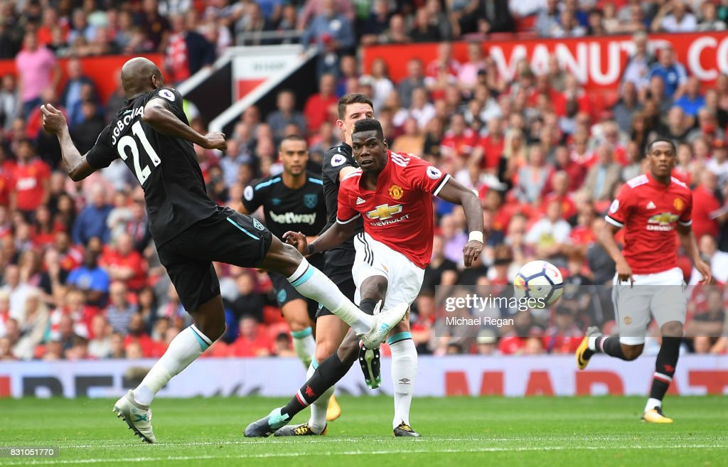 Paul Pogba of Manchester United scores his sides fourth goal during the Premier League match between Manchester United and West Ham United at Old Trafford on August 13, 2017 in Manchester, England.