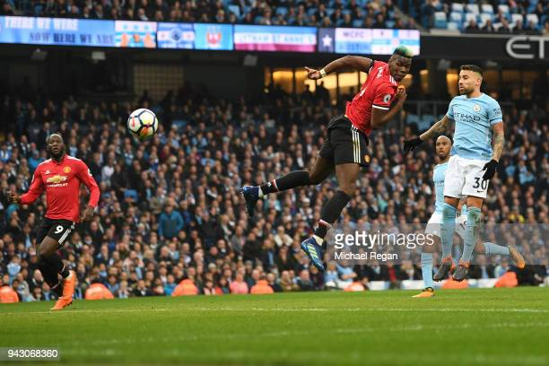 Paul Pogba of Manchester United scores his sides second goal during the Premier League match between Manchester City and Manchester United at Etihad...