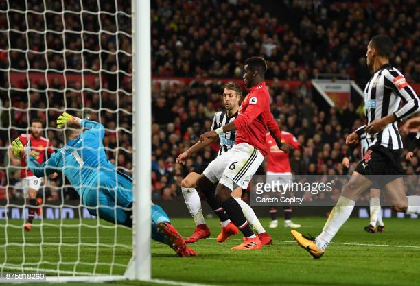 Paul Pogba of Manchester United scores his sides third goal during the Premier League match between Manchester United and Newcastle United at Old...