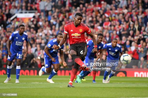 Paul Pogba of Manchester United scores his team's first goal during the Premier League match between Manchester United and Leicester City at Old...