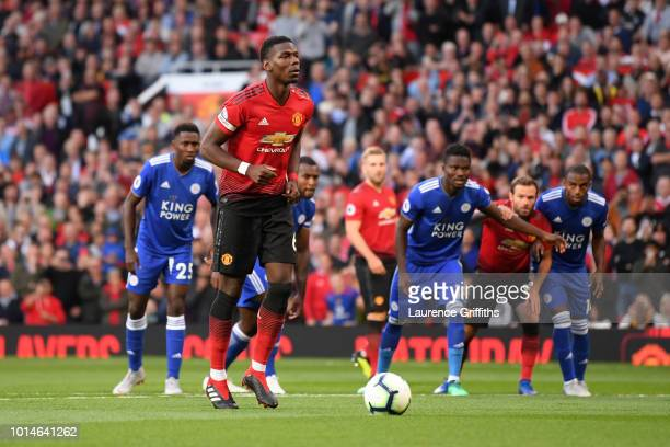 Paul Pogba of Manchester United scores his team's first goal from the penalty spot during the Premier League match between Manchester United and...