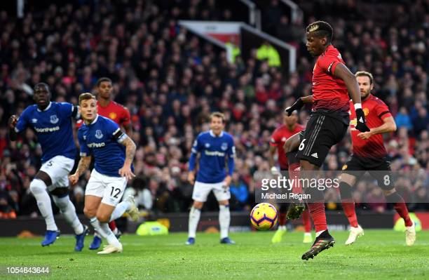 Paul Pogba of Manchester United scores his team's first goal on the rebound of a missed penalty during the Premier League match between Manchester...
