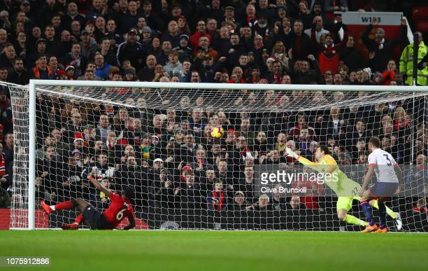 Paul Pogba of Manchester United scores his team's first goal past Asmir Begovic of AFC Bournemouth during the Premier League match between Manchester...