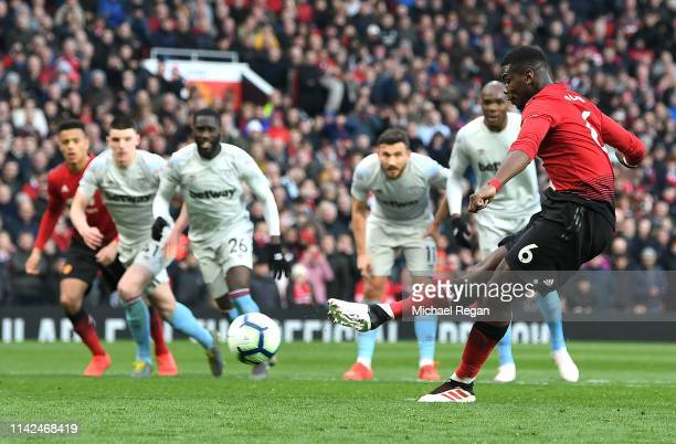 Paul Pogba of Manchester United scores his team's second goal from a penalty during the Premier League match between Manchester United and West Ham...