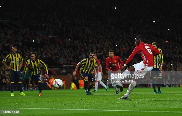 Paul Pogba of Manchester United scores the opening goal from the penalty spot during the UEFA Europa League Group A match between Manchester United...