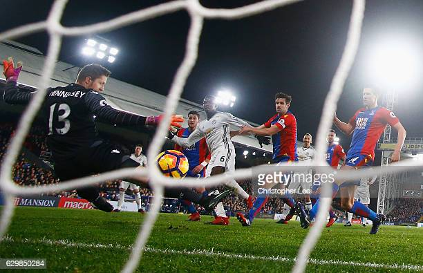 Paul Pogba of Manchester United scores the opening goal past Wayne Hennessey of Crystal Palace during the Premier League match between Crystal Palace...