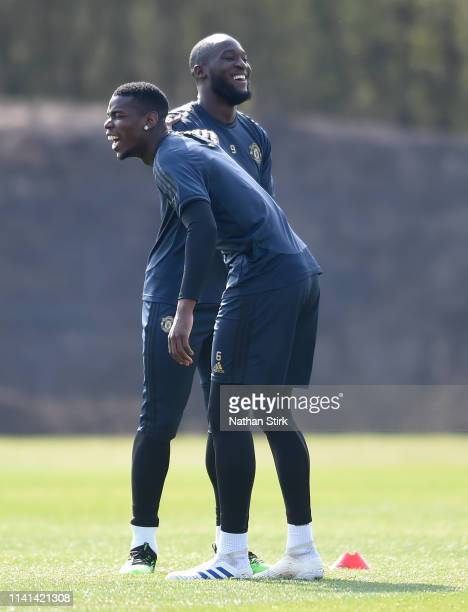 Paul Pogba of Manchester United shares a joke with Romelu Lukaku of Manchester United during the Manchester United training session ahead of the UEFA...