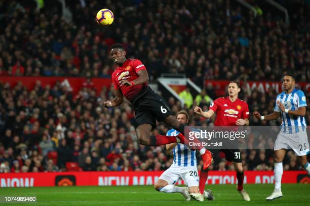 Paul Pogba of Manchester United shoots a header during the Premier League match between Manchester United and Huddersfield Town at Old Trafford on...