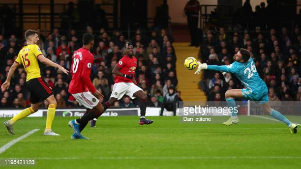Paul Pogba of Manchester United shoots but the shot is saved by Ben Foster of Watford during the Premier League match between Watford FC and...