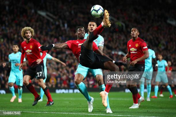 Paul Pogba of Manchester United shoots from an overhead kick during the Premier League match between Manchester United and Newcastle United at Old...