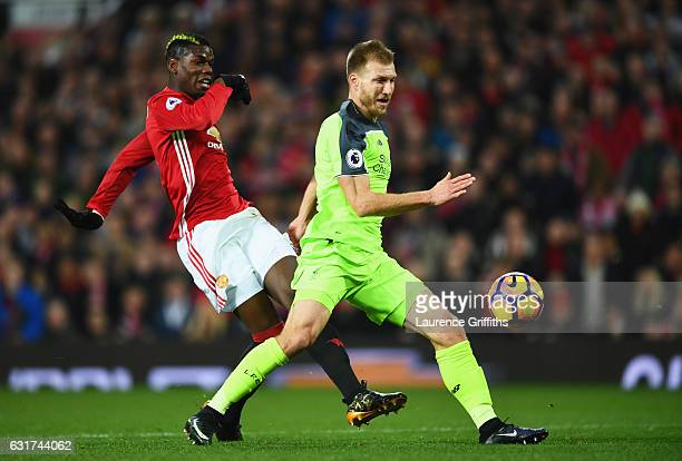 Paul Pogba of Manchester United shoots past Ragnar Klavan of Liverpool during the Premier League match between Manchester United and Liverpool at Old...