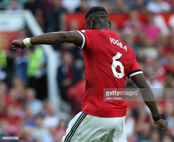 Paul Pogba of Manchester United shows off a hairstyle with Equal shaved into his head during the Premier League match between Manchester United and...