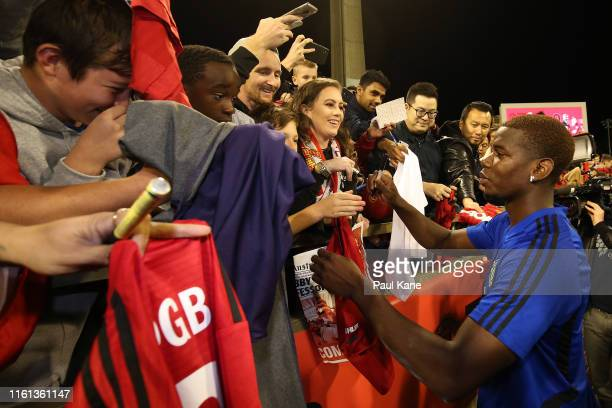 Paul Pogba of Manchester United signs autographs for fans during a Manchester United training session at the WACA on July 11, 2019 in Perth,...