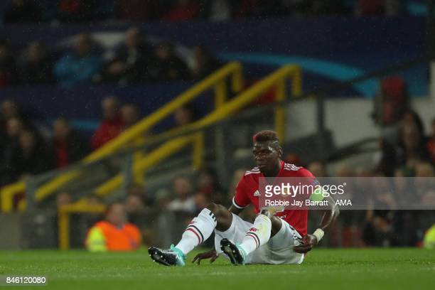 Paul Pogba of Manchester United sits injured with a hamstring issue during to the UEFA Champions League match between Manchester United and FC Basel...