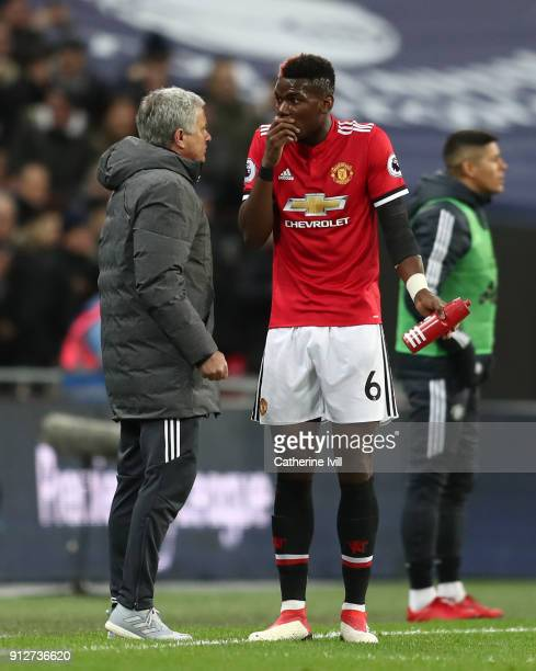 Paul Pogba of Manchester United speaks to Jose Mourinho Manager of Manchester United during the Premier League match between Tottenham Hotspur and...