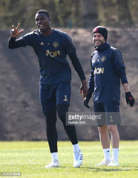 Paul Pogba of Manchester United speaks to Juan Mata of Manchester United during the Manchester United training session ahead of the UEFA Champions...
