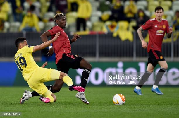 Paul Pogba of Manchester United stretches for the ball whilst under pressure from Francis Coquelin of Villarreal CF during the UEFA Europa League...