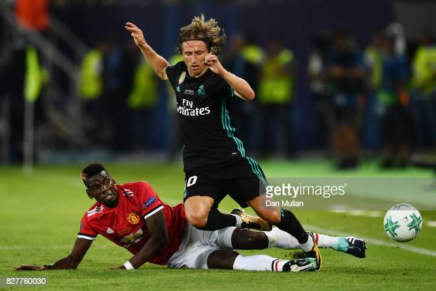 Paul Pogba of Manchester United tackles Luka Modric of Real Madrid during the UEFA Super Cup final between Real Madrid and Manchester United at the...