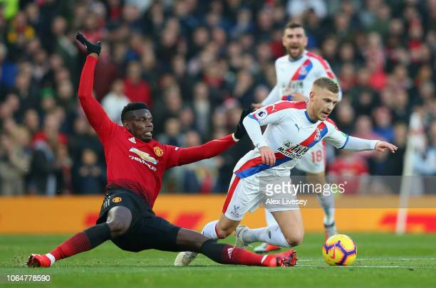 Paul Pogba of Manchester United tackles Max Meyer of Crystal Palace during the Premier League match between Manchester United and Crystal Palace at...