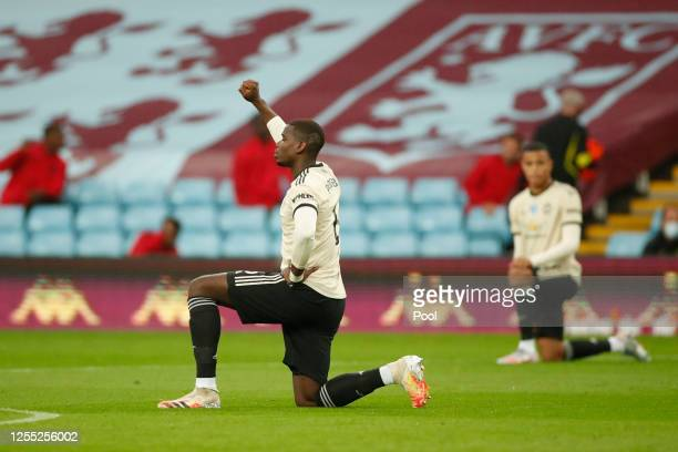 Paul Pogba of Manchester United takes a knee in support of the Black Lives Matter movement prior to the Premier League match between Aston Villa and...