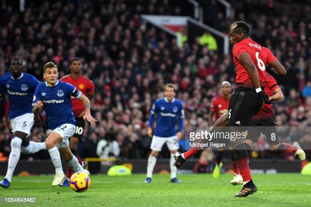 Paul Pogba of Manchester United takes a penalty which is saved by Jordan Pickford of Everton during the Premier League match between Manchester...