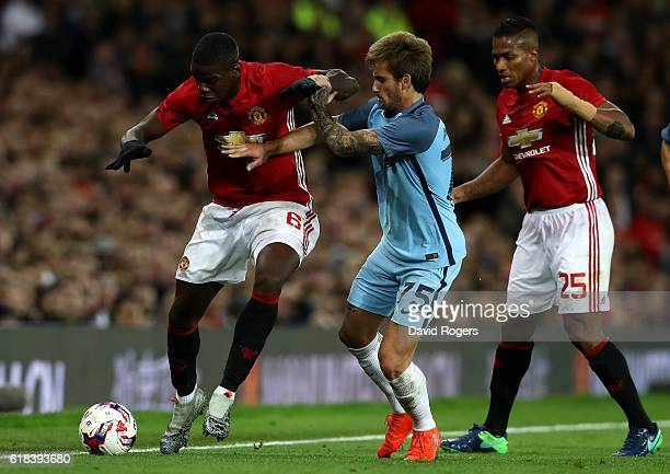 Paul Pogba of Manchester United takes on Aleix Garcia of Manchester City during the EFL Cup fourth round match between Manchester United and...
