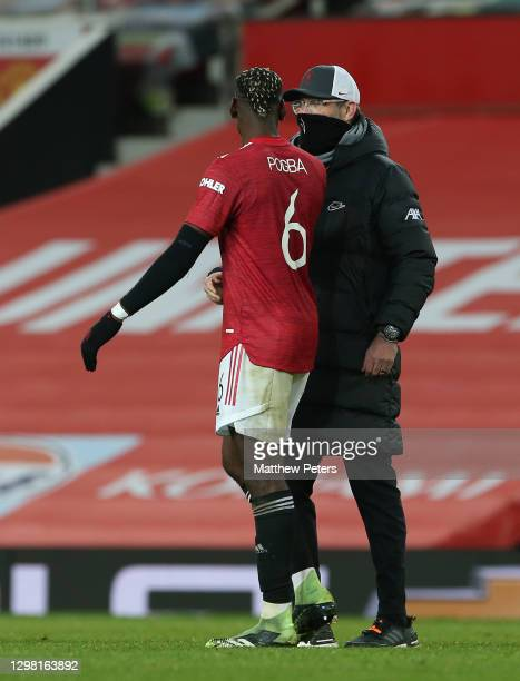 Paul Pogba of Manchester United talks to Manager Jurgen Klopp of Liverpool after the Emirates FA Cup Fourth Round match between Manchester United and...