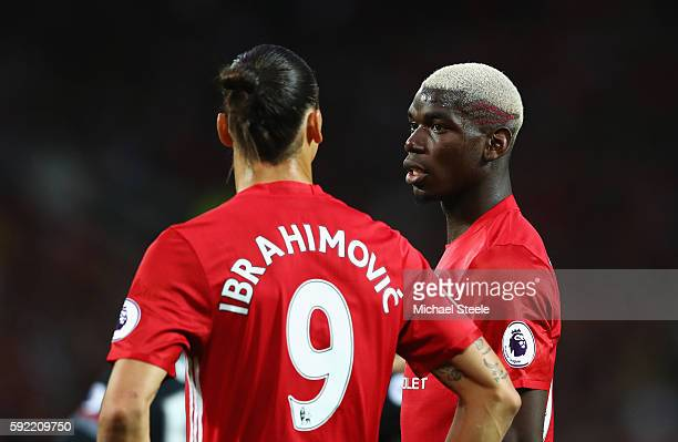 Paul Pogba of Manchester United talks to Zlatan Ibrahimovic during the Premier League match between Manchester United and Southampton at Old Trafford...