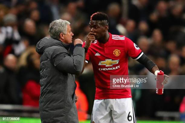 Paul Pogba of Manchester United talks with Jose Mourinho Manager of Manchester United on the sidelines during the Premier League match between...