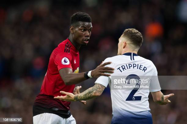 Paul Pogba of Manchester United tries to calm down Kieran Trippier of Tottenham Hotspur during the Premier League match between Tottenham Hotspur and...