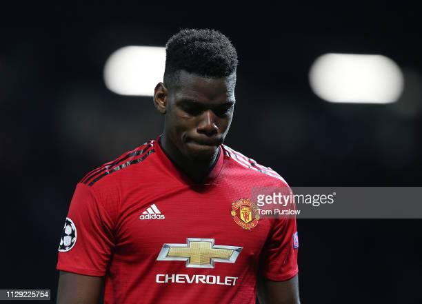 Paul Pogba of Manchester United walks off after being sent off during the UEFA Champions League Round of 16 First Leg match between Manchester United...