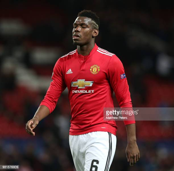 Paul Pogba of Manchester United walks off after the UEFA Champions League Round of 16 Second Leg match between Manchester United and Sevilla FC at...