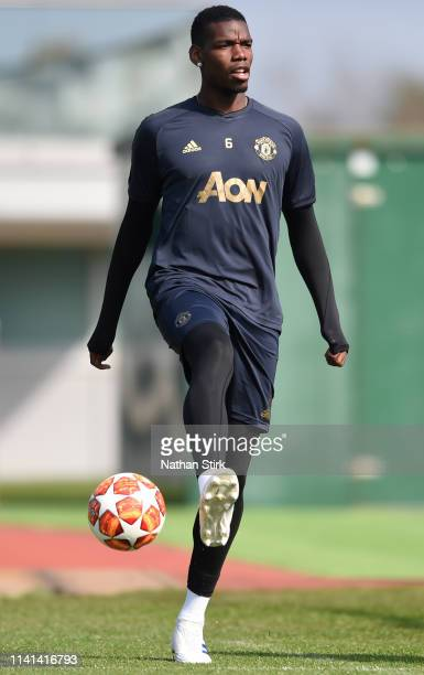 Paul Pogba of Manchester United walks out to train during the Manchester United training session ahead of the UEFA Champions League Quarter Final...