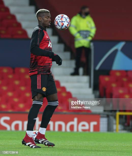 Paul Pogba of Manchester United warms up ahead of the UEFA Champions League Group H stage match between Manchester United and RB Leipzig at Old...