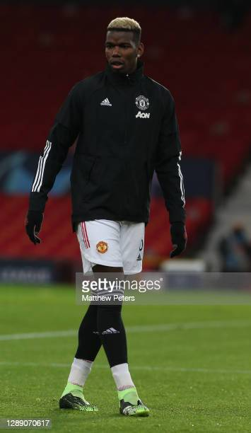 Paul Pogba of Manchester United warms up ahead of the UEFA Champions League Group H stage match between Manchester United and Paris Saint-Germain at...
