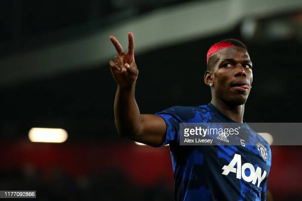 Paul Pogba of Manchester United warms up prior to the Carabao Cup Third Round match between Manchester United and Rochdale AFC at Old Trafford on...
