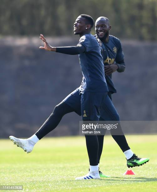 Paul Pogba of Manchester United warms up with Romelu Lukaku of Manchester United during the Manchester United training session ahead of the UEFA...