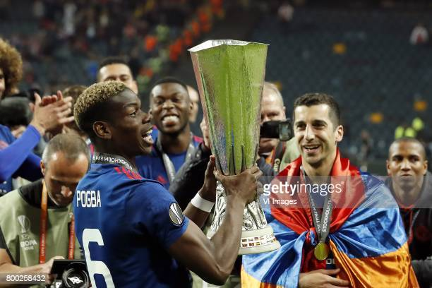 Paul Pogba of Manchester United with the Coupe UEFA the UEFA cup the Europa League trophy Henrikh Mkhitaryan of Manchester Unitedduring the UEFA...