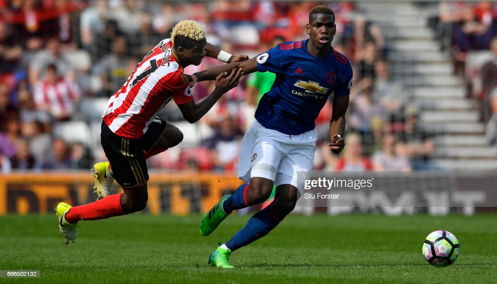 Paul Pogba of United brushes off the challenge of Didier Ndong of Sunderland during the Premier League match between Sunderland and Manchester United at Stadium of Light on April 9, 2017 in Sunderland, England.