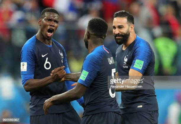 Paul Pogba Samuel Umtiti and Adil Rami of France celebrate following their sides victory in the 2018 FIFA World Cup Russia Semi Final match between...