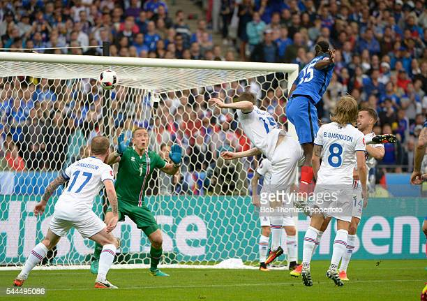 Paul Pogba scores the second goal for France during the UEFA EURO 2016 quarter final match between France and Iceland at Stade de France on July 3...